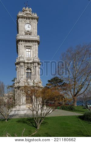 ISTANBUL, TURKEY - MARCH 22, 2014: View to Dolmabahce Clock Tower from South in a spring day. The tower was designed by the court architect Sarkis Balyan between 1890 and 1895