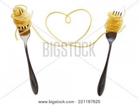 Swirls of cooked spaghetti with fork. Spaghetti heart shape.