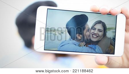 Happy young couple having fun and taking a selfie
