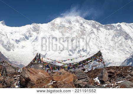 Buddhist prayer flags and Mount Annapurna from Annapurna base camp, Himalaya,  Nepal