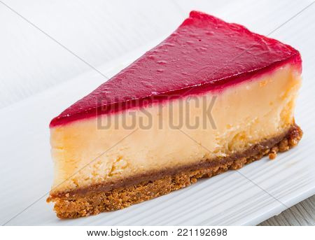 a slice of cheesecake on white dish