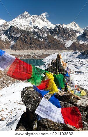 view of Mount Everest and Lhotse with buddhist prayer flags from Gokyo Ri - way to Everest base camp, Sagarmatha national park, Khumbu valley, Solukhumbu, Nepal Himalayas