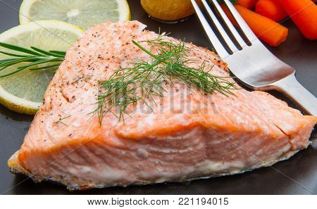 Salmon Fillet With Baked Onion And Carrot