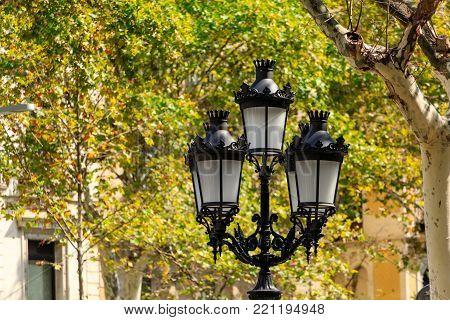 A Traditional Iron Streetlight in Barcelona Spain