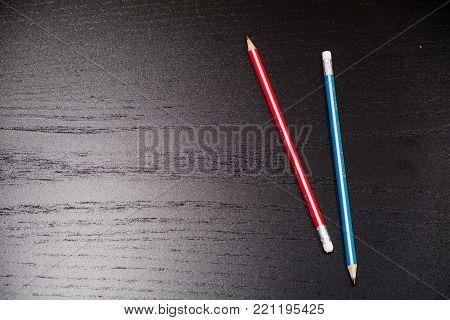 Closeup of pencil eraser on wooden table, soft focus. Mistake erase concept.