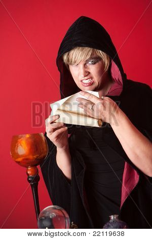 Evil witch reciting spells from a scroll poster