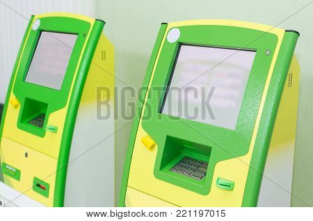 business, money, electronics concept. there are few new electronic terminals of green and yellow colours, very handy tool for safekeeping your resources and operates with them