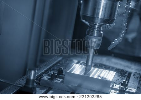The CNC milling machine cutting the sample part.The end-mill tool cutting the mold part by CNC milling machine.
