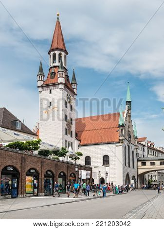 Munich, Germany - May 29, 2016: Local and tourists walk near the Old Town Hall in Munich, Bavaria, Germany.(Altes Rathaus) in Munich, Bavaria, Germany.