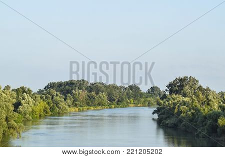 River Kuban. Water smooth surface and coastal woods.