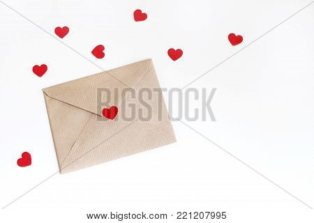 Valentines day or wedding mockup scene with envelope, red paper hearts confetti isolated on white background. Styled stock photo, flat lay, top view, empty space for your text.