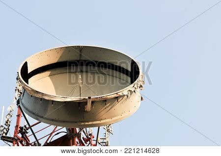 Top of Communication Tower with antennas such a Mobile phone tower, Cellphone Tower, Phone Pole etc stand on the mountain on white sky background.