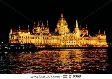 The Hungarian Parliament Building National Assembly of Hungary night shoot from the Buda side - Famous tourist attraction of Hungary by the river Danube
