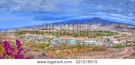 Beautiful panorama from the air from Chayofita mountain peaks over the comercial area and Los America Golf in Tenerife, Canary island of Spain