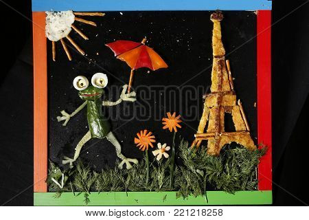 Symbols of France frog and tower.The Eiffel Tower made from food