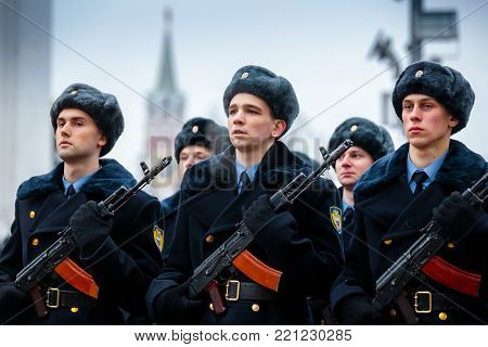 MOSCOW, RUSSIA - DECEMBER 09, 2017: Formation of the Presidential Regiment of the Service of Moscow Kremlin's Commandant of the Federal Guard Service of the Russian Federation. Winter view. Cathedral Square, Kremlin, Moscow.