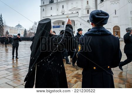 MOSCOW, RUSSIA - DECEMBER 09, 2017: Blessing the troops of the Presidential Regiment of the Service of Moscow Kremlin's Commandant of the Federal Guard Service of the Russian Federation. Winter view. Cathedral Square, Kremlin, Moscow.