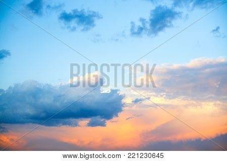 clear blue sky with plain white cloud with space for text background. The vast blue sky and clouds. blue sky background with tiny clouds nature.