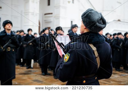 MOSCOW, RUSSIA - DECEMBER 09, 2017: Military oath of the Presidential Regiment of the Service of Moscow Kremlin's Commandant of the Federal Guard Service of the Russian Federation. Winter view. Cathedral Square, Kremlin, Moscow.