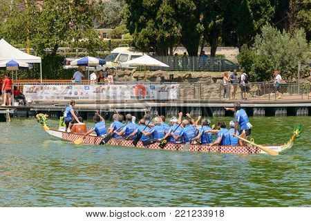 Rome, Italy - July 30, 2016: Dragon boat crews  compete at the european championships held in Italy in 2016 summer, Italian crew after the race