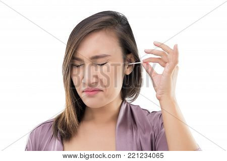 Asian women in robes cleans her ears with a cotton swab against white background, Hygiene and people concept