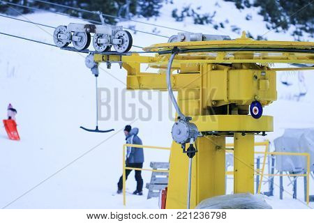 Mechanism of transportation cable lift on the snow mountain. Uludag the ancient Mysian Olympus and Bithynian Olympus, is a mountain in Bursa Province, Turkey. Ski lifts durings bright winter day.