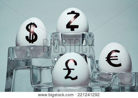The inscription on chicken eggs for advertising and promotion of various currencies and crypto. Written or drawn symbols British pound sterling. dollar. Euro. Zcash.