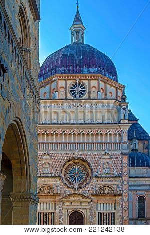 Part of facade from Basilica of Santa Maria Maggiore, Cappella Coleoni, Piazza Duomo, Bergamo Alta Citta, Italy. Romanesque architecture with a gilded interior hung with tapestries, built in 1137.
