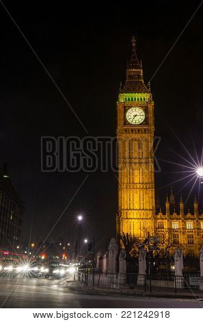 Night time photograph of the famous landmark clock tower known as Big Ben in Parliament Square, London, England, part of the Palace of Westminster also known as the Houses of Parliament.