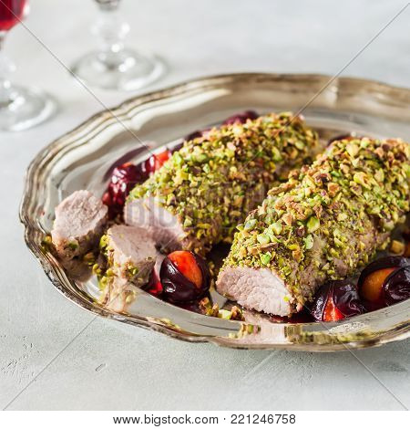 Sliced Pistachio Crusted Pork Tenderloin with Plums on a Vintage Dish, square