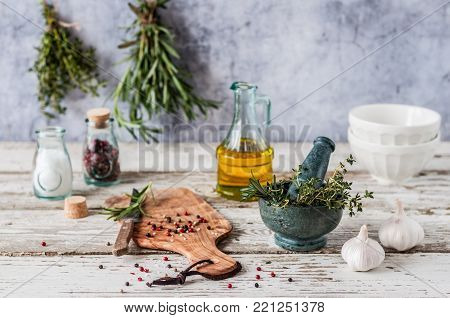 Herbs and Spices, Mortar and Pestle, Thyme, Posemary, Olive Oil, Salt Crystals and Whole Peppercorns, copy space for your text