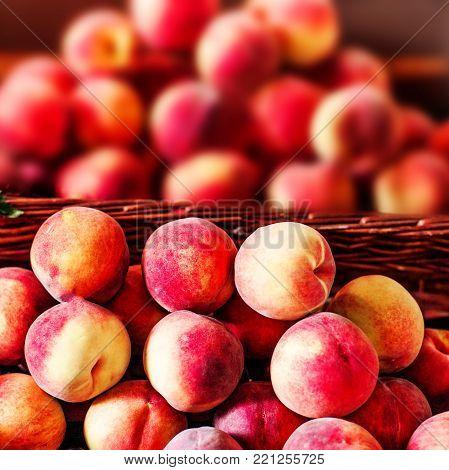 Organic fresh ripe peaches  a local farmer market.  Nectarines on display stall. Healthy local food market concept.