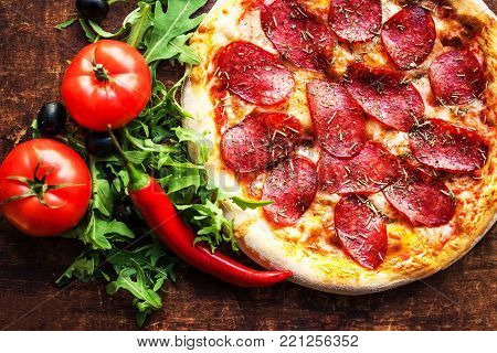 Pizza with tomatoes, cheese, pepper, herbs and olive  Ready to Eat. Fresh baked pepperoni pizza