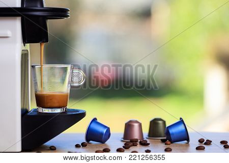 Espresso Coffee Machine On A Wooden Table, Blur Background, Space For Text