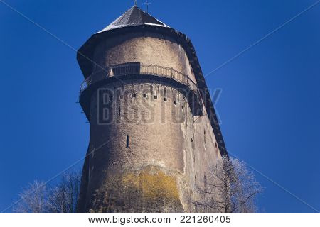 Tower. Famous Orava Castle ( Oravsky hrad ) on background of blue sky. Bottom view. Orava Podzamok. National Monument of Culture of Slovakia. Travel destination for vacations