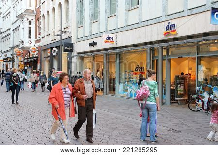 LUBECK, GERMANY - AUGUST 29, 2014: People shop in Lubeck, Germany. Lubeck is the 2nd largest city in Schleswig-Holstein region.