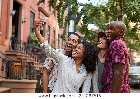 Group Of Friends Posing For Selfie On Street In New York City