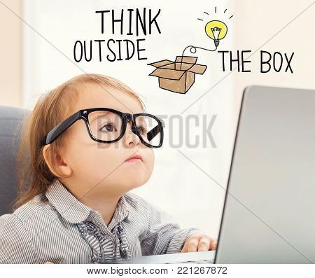 Think Outside The Box text with toddler girl using her laptop