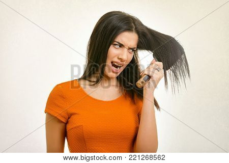 Tangled messy problem hair stuck on hairbrush