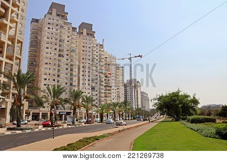 ASHKELON, ISRAEL - SEPTEMBER 19, 2017: Modern residential buildings on avenue in Ashkelon - popular tourist resort and coastal city in Southern District of Israel on Mediterranean coast