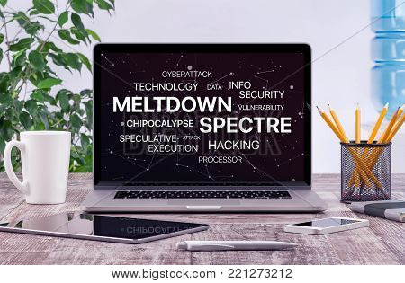 Meltdown and spectre threat concept. Chipocalypse meltdown and spectre threat on laptop screen in office workplace.