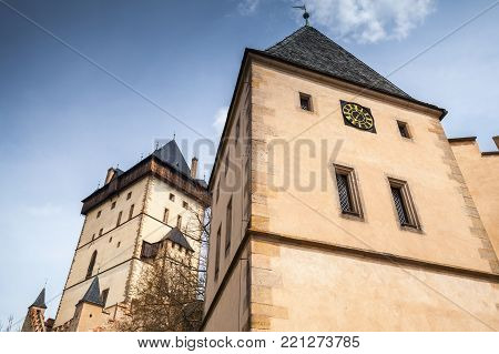 Karlstejn castle towers under blue sky. large Gothic castle founded 1348 CE by Charles IV, Holy Roman Emperor-elect and King of Bohemia. Located in Karlstejn village, Czech Republic