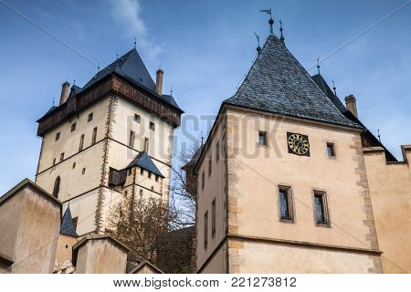 Karlstejn castle towers under blue sky. Gothic castle founded 1348 CE by Charles IV, Holy Roman Emperor-elect and King of Bohemia. Located in Karlstejn village, Czech Republic