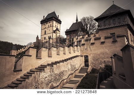 Karlstejn castle exterior. Gothic castle founded 1348 CE by Charles IV, Holy Roman Emperor-elect and King of Bohemia. Located in Karlstejn village, Czech Republic. Vintage toned photo