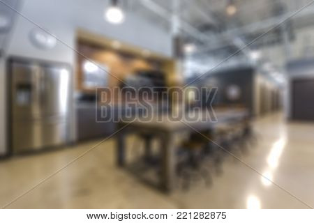Abstract blurred background of kitchen interior in modern office, shallow depth of focus.