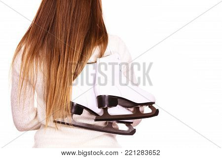 Woman carrying a pair of ice skates getting ready for ice skating, winter sport activity. Back view isolated on white