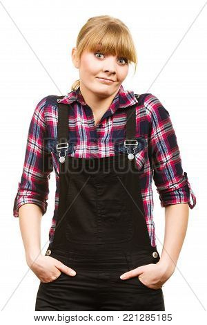 Gardening fahion concept. Attractive woman in pink check shirt and dungarees, shocked surprised face expression. Isolated background