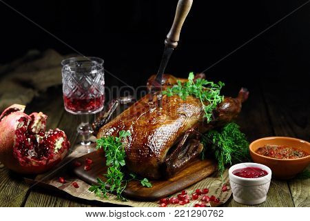 roast duck with cranberry sauce and pomegranate