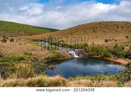 Beautiful landscape of river flowing through montane grassland in Horton Plains National Park, Sri Lanka
