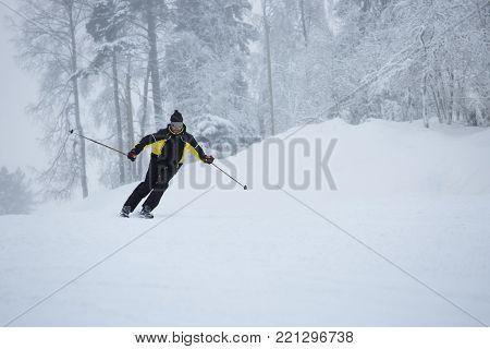 Happy Skier Using T-bar Ski Drag Lift